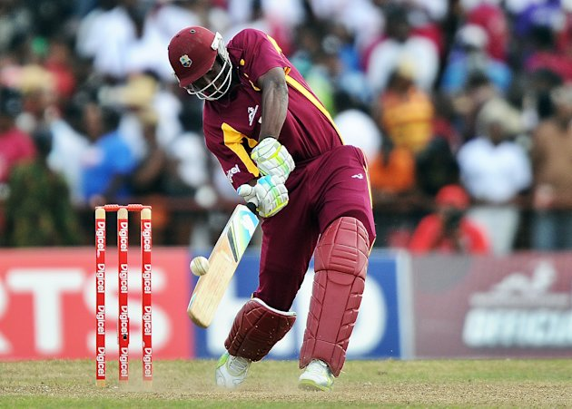West Indies cricketer Andre Russell hits
