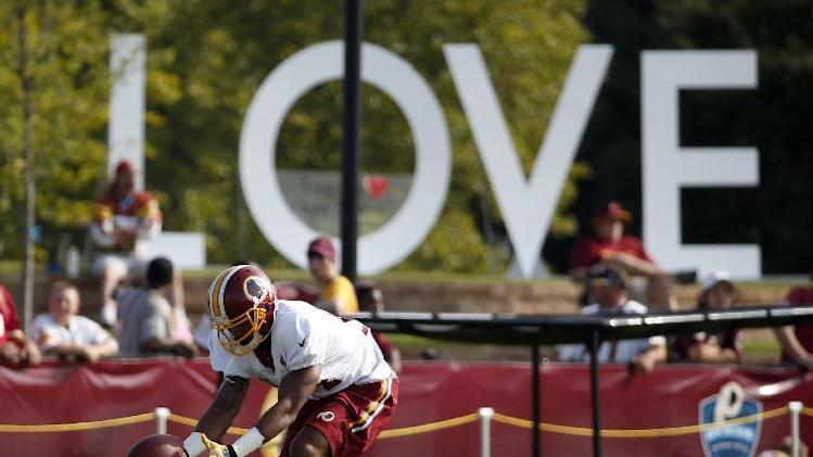 Washington Redskins receiver Ryan Grant catches the ball during practice at the team's NFL football training facility, Saturday, July 26, 2014 in Richmond, Va