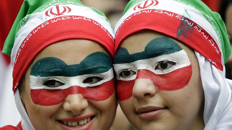 Iranian fans wait for the start of the group F World Cup soccer match between Bosnia and Iran at the Arena Fonte Nova in Salvador, Brazil, Wednesday, June 25, 2014