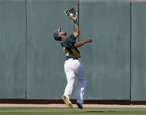 Young hits slam, Colon goes 5 as A's beat Brewers