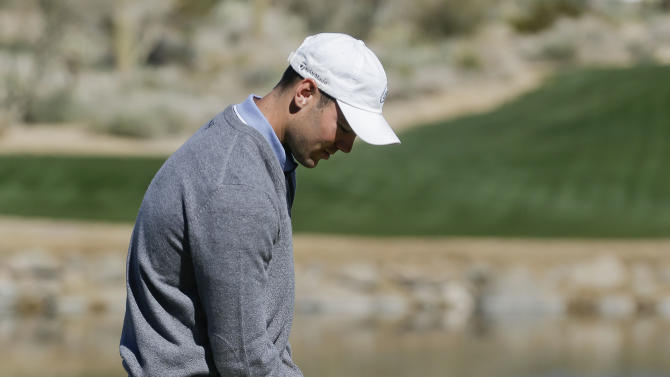Germany's Martin Kaymer reacts after missing a putt on the third green during a third round against against Hunter Mahan at the Match Play Championship golf tournament, Saturday, Feb. 23, 2013, in Marana, Ariz. (AP Photo/Julie Jacobson)