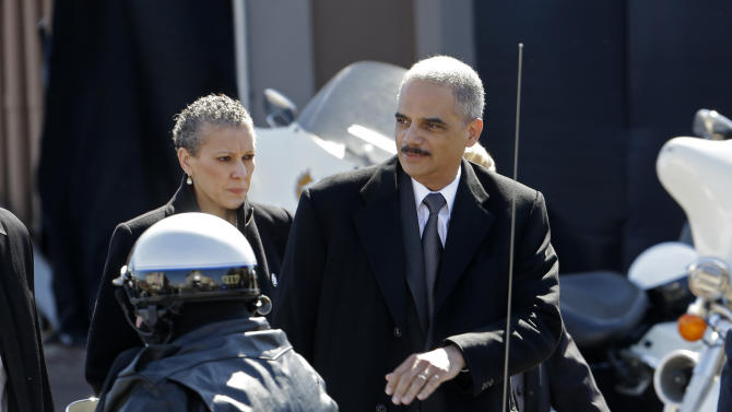 U.S. Attorney General Eric Holder arrives in Selma, Ala., Sunday, March 3, 2013. Holder and Vice President Joe Biden addressed thousands who gathered for the annual Bridge Crossing Jubilee on the 48th anniversary of Bloody Sunday, when Alabama State Troopers beat back marchers when they tried to cross the Edmund Pettus Bridge. (AP Photo/Dave Martin)