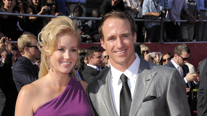 New Orleans Saints quarterback Drew Brees, right, and Brittany Brees arrive at the ESPY Awards on Wednesday, July 11, 2012, in Los Angeles. (Photo by Chris Pizzello/Invision/AP)