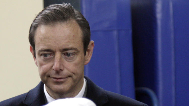 Leader of the NVA party Bart De Wever, top, waits in line to cast his vote at a polling station in Antwerp, Belgium, on Sunday Oct. 14, 2012. NVA, a separatist party, wants to use Antwerp as a base for breaking away from Belgium, putting it in the forefront of a European breakaway trend just as the EU celebrates winning the Nobel Peace Prize for fostering continental unity. (AP Photo/Virginia Mayo)