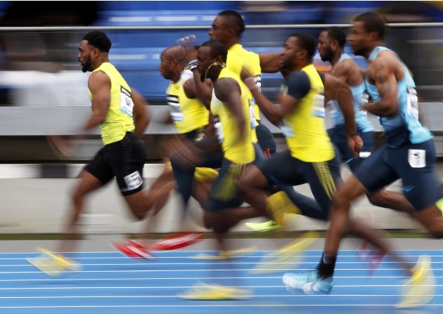 Tyson Gay of the U.S. leads the field winning his men's 100 meters semi-final heat at the Diamond League Adidas Grand Prix in New York