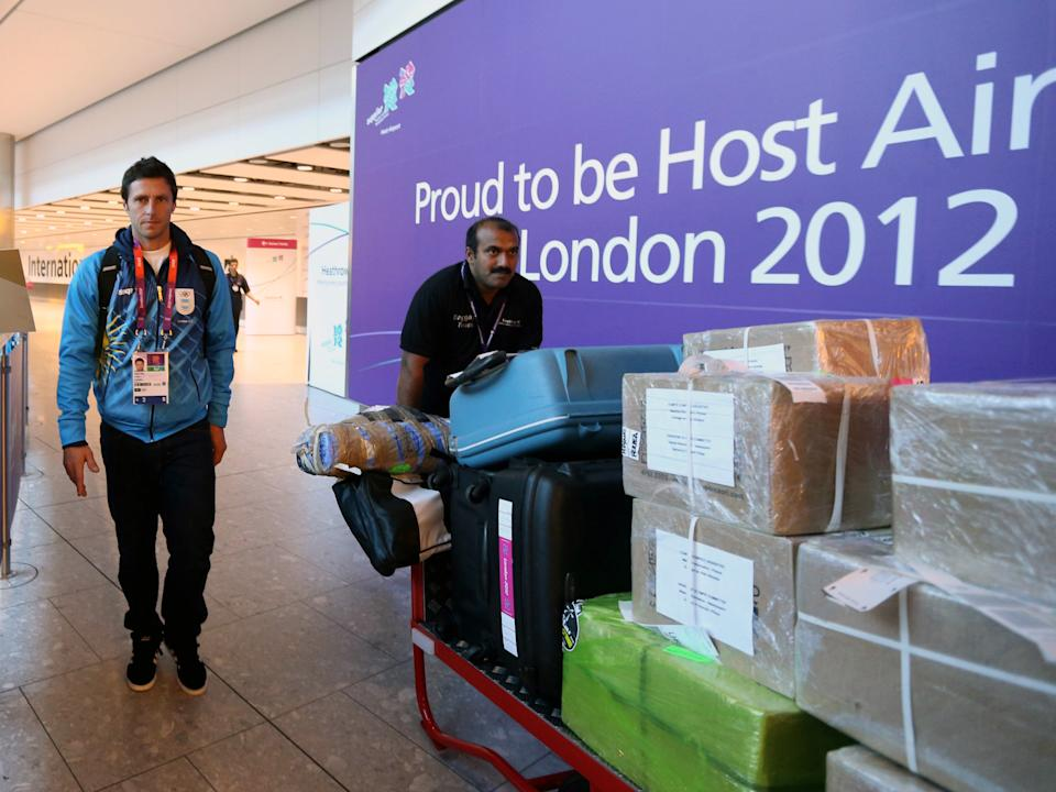 Argentina hockey player Matias Damian Vila arrives at Heathrow Airport, in London for the 2012 Summer Olympics on Wednesday July 25, 2012. (AP Photo/Steve Parsons, PA) UNITED KINGDOM OUT; NO SALES; NO ARCHIVE