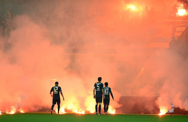 Berlin's Fans Throw Firework On The Pitch   RESTRICTIONS / EMBARGO - DFL LIMITS THE USE OF IMAGES ON THE INTERNET TO 15 AFP/Getty Images