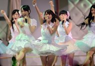 Yuko Oshima (C) and AKB48 group members perform during the AKB48 General Election show in Tokyo on June 6. Oshima dominated Thursday's newspapers after her victory in a popular ballot for the top spot in one of the world's highest grossing acts