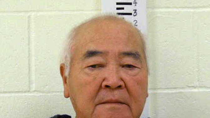 In this undated photo provided by York County Jail, James Pak, 74, of Biddeford, Maine, stands during a booking photo. Pak is to face charges Monday, Dec. 31, 2012 in the shooting deaths Saturday of two of his tenants after a possible dispute over where they parked their cars during a snowstorm, state police said. (AP Photo/York County Jail)