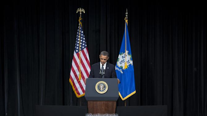 President Barack Obama pauses as he delivers a speech at an interfaith vigil for the victims of the Sandy Hook Elementary School shooting on Sunday, Dec. 16, 2012 at Newtown High School in Newtown, Conn. A gunman walked into Sandy Hook Elementary School on Friday and opened fire, killing 26 people, including 20 children. (AP Photo/ Evan Vucci)