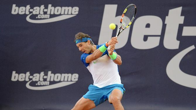 Spain's Rafael Nadal returns the ball during his first round match against Spain's Fernando Verdasco at the ATP tournament in Hamburg, northern Germany on July 28, 2015