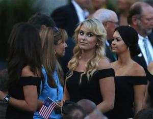 U.S. skier Vonn and girlfriend of golfer Tiger Woods looks into the crowd as she enters the opening ceremonies for the 2013 Presidents Cup golf tournament in Columbus
