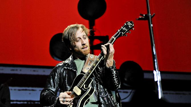 """FILE - In this March 12, 2012 file photo, guitarist/vocalist Dan Auerbach of The Black Keys performs at Madison Square Garden, in New York. The Black Keys sued Pizza Hut and Home Depot on June 22, 2012, in Los Angeles, claiming the corporations violated their copyrights by using elements of their songs """"Gold on the Ceiling"""" and """"Lonely Boy"""" in advertisements. (AP Photo/Evan Agostini, File)"""