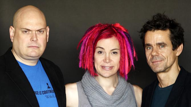 """This Oct. 14, 2012 photo shows directors- screenwriters Andy Wachowski, left, Lana Wachowski, center, and Tom Tykwer, from the upcoming film """"Cloud Atlas"""", in Beverly Hills, Calif. The film is an epic of shifting genres and intersecting souls that features Tom Hanks, Halle Berry, Jim Broadbent, Hugh Grant, Hugo Weaving, Ben Whishaw, Jim Sturgess, James D'Arcy, Doona Bae, Keith David, Sarandon and others in multiple roles spanning the centuries. (Photo by Matt Sayles/Invision/AP)"""