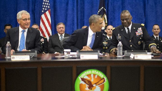 In this Sept. 17, 2014 photo, President Barack Obama, center, with Sec. of Defense Chuck Hagel, left, and Gen. Lloyd J. Austin III, right, Commander of the US Central Command (CentCom), before the start of a briefing at MacDill Air Force Base, Fla.  Obama's military campaign against Islamic State extremists has already crept beyond the narrow parameters he first outlined three months ago.  But military experts both inside and outside of the administration argue that even more may be needed for the mission to succeed, including embedding U.S. ground troops with Iraqi security forces who are on the front line of the fight against the violent militants.  (AP Photo/Pablo Martinez Monsivais)