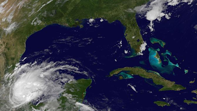 This image provided by NOAA shows Tropical Storm Barry taken at 4:45 a.m. EDT Thursday June 20, 2013. The U.S. National Hurricane Center said the storm was about 30 miles (45 kilometers) north of the port city of Veracruz early Thursday and heading west at 5 mph (7 kph). Barry, which has sustained 45-mph (75-kph) winds, is expected to make landfall northwest of that city. (AP Photo/NOAA)