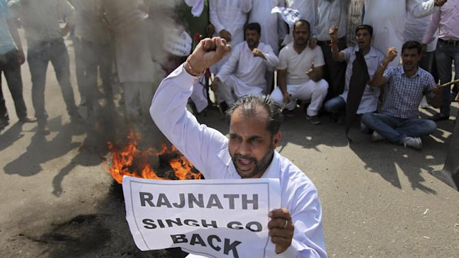 Activists of Jammu and Kashmir National Panthers Party shout slogans during a shutdown in Jammu, India, Wednesday, May 27, 2015. Closed markets and empty roads greeted India's Home Minister Rajnath Singh who visited Jammu to address a rally Wednesday as the city is observing a day-long bandh or a shutdown to protest against the shifting of proposed health care institution All India Institute of Medical Sciences (AIIMS) from Jammu to Srinagar, the summer capital of India's Jammu-Kashmir state. (AP Photo/Channi Anand)