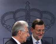 <p>               Spain's Prime Minister Mariano Rajoy, right, and Italy's Prime Minister Mario Monti, left, leave after a press conference at the Moncloa Palace in Madrid, Spain, Thursday, Aug. 2, 2012. (AP Photo/Andres Kudacki)