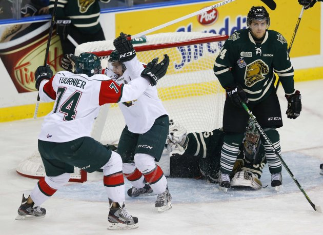 Halifax Mooseheads' Ashley celebrates his goal with Fournier while London Knights' Mermis and Patterson react during the Memorial Cup Canadian Junior Hockey Championships in Saskatoon.