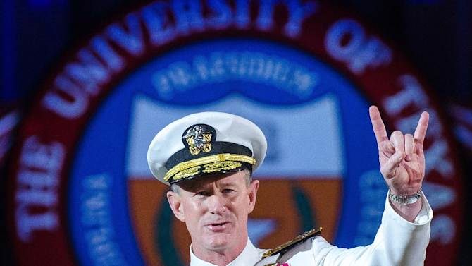 FILE - In this May 17, 2014 file photo Naval Adm. William H. McRaven, an alumnus, does the Longhorns' Hook 'em Horns hand signal during his commencement keynote address at the University of Texas in Austin. The University of Texas System regents on Tuesday, July 29, 2014, selected McRaven as the lone finalist for the job of chancellor, overseeing the system's 15 campuses and $14 billion budget. (AP Photo/ The University of Texas at Austin, Marsha Miller, File)