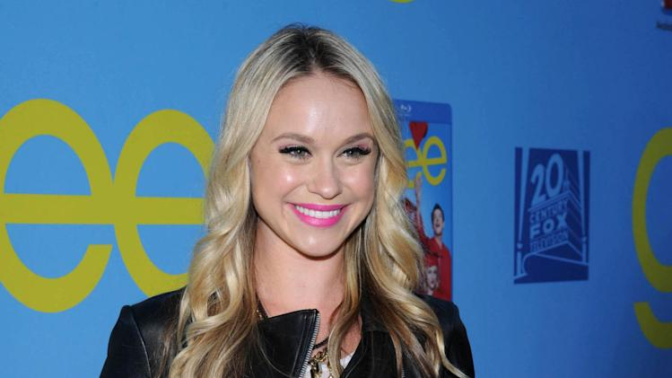 "This Sept. 12, 2012 photo released by Fox shows Becca Tobin posing on the red carpet for the season four premiere screening of ""Glee,"" in the Hollywood section of Los Angeles. Matt Bendik, the boyfriend of ""Glee"" star Becca Tobin, has been found dead in a Philadelphia hotel room. Police say they were called to the Hotel Monaco just after 1 p.m. Thursday, July 10, 2014, and that a man was pronounced dead minutes later. The city medical examiner's office confirmed Bendik's identity and will determine the cause and manner of death. There were no signs of foul play. (AP Photo/FOX, Vince Bucci)"
