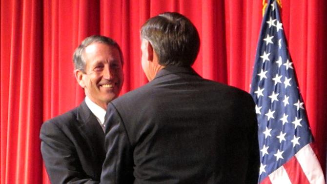 Former South Carolina Gov. Mark Sanford, left, greets former Charleston County councilman Curtis Bostic before a debate in Charleston, S.C., on Thursday, March 28, 2013. The two face each other Tuesday in a runoff for the Republican nomination for South Carolina's vacant 1st Congressional District seat. (AP Photo/Bruce Smith)