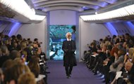 German fashion designer Karl Lagerfeld acknowledges applause at the end of the presentation for Chanel, as part of his Women's Spring Summer 2012 Haute Couture fashion collection presented in Paris, Tuesday, Jan. 24, 2012. (AP Photo/ Jacques Brinon)