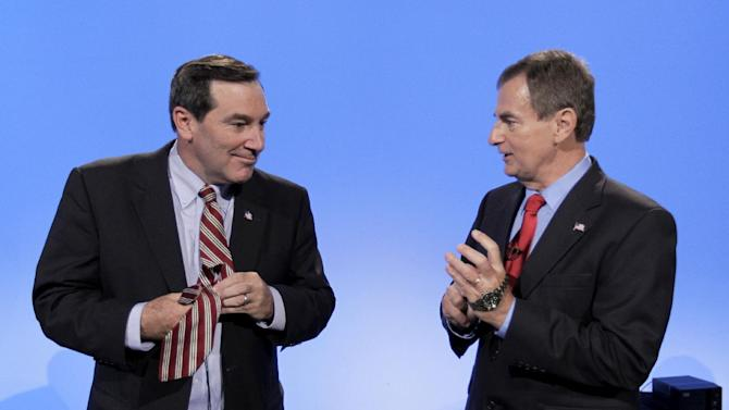 "FILE - This Oct. 15, 2012 file photo shows Indiana Senate candidates, Democrat Joe Donnelly, left, and Republican Richard Mourdock talk after participating in a debate in Indianapolis. Fresh signs that Democrats could snatch Indiana's Senate seat from the Republicans make it distinctly harder for the GOP to seize the Senate majority in Tuesday's election. The latest survey out of Indiana Friday showed Democratic Rep. Joe Donnelly leading Republican Richard Mourdock by 11 percentage points after the GOP candidate's awkward debate comment last week that pregnancy resulting from rape is ""something God intended."" (AP Photo/Michael Conroy, File)"