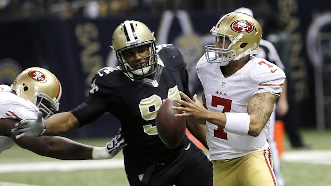 San Francisco 49ers quarterback Colin Kaepernick (7) scrambles as New Orleans Saints defensive end Cameron Jordan (94) pursues in the first half of an NFL football game at the Louisiana Superdome in New Orleans, Sunday, Nov. 25, 2012. (AP Photo/Bill Haber)