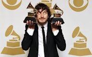Gotye poses backstage with the awards for best pop duo/group performance for &quot;Somebody That I Used to Know&quot; and best alternative music album for &quot;Making Mirrors&quot; at the 55th annual Grammy Awards on Sunday, Feb. 10, 2013, in Los Angeles. (Photo by Matt Sayles/Invision/AP)