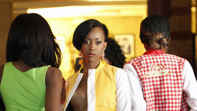 Models sport the clothes  of South African designer Santos Sdizo during  the first day of  the Soweto  Fashion Week in Soweto, South Africa , Thursday May 24, 2012. Designers and entrepreneurs who have got together to put on a fashion show in Soweto are inspired by the famed township's creativity and history.(AP Photo/Jerome Delay)