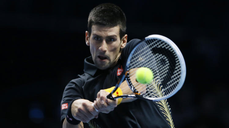 Novak Djokovic of Serbia plays a return to Tomas Berdych of Czech Republic during their ATP World Tour Finals singles tennis match at the O2 Arena in London, Friday, Nov. 9, 2012. (AP Photo/Kirsty Wigglesworth)