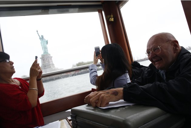 Father Foster smiles while on a boat tour of Manhattan in New York