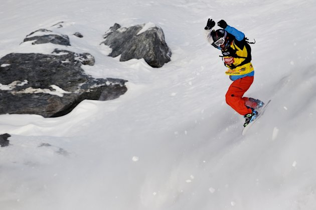 France's Jonathan Charlet competes in the New 2012 Freeride World Champion at the Men's snowboard event on the Bec de Rosses mountain during the Xtreme Freeride World Tour final on March 24, 2012 abov