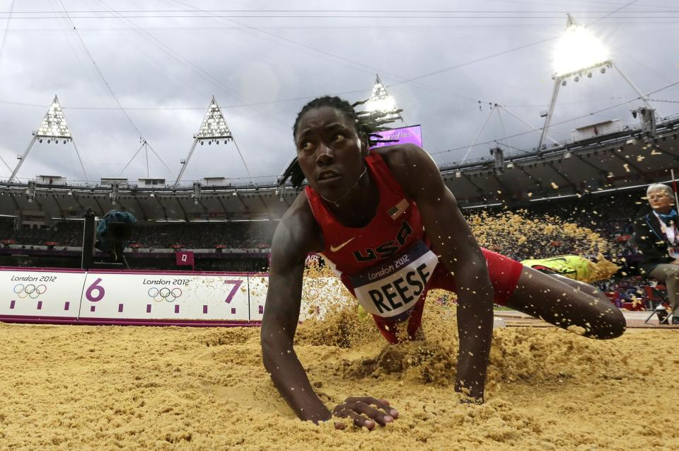 United States' Brittney Reese competes in a women's long jump qualification round during the athletics in the Olympic Stadium at the 2012 Summer Olympics, London, Tuesday, Aug. 7, 2012. (AP Photo/David J. Phillip)