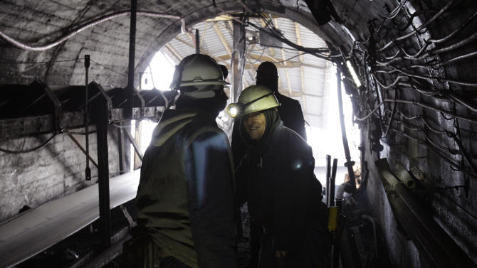 Women miners Sakiba Colic, right, and Semsa Hadzo, left, Bosnian coal technologists, ride a coal mine train on the way out of the shaft at the end of their 8-hour shift at 450 meters underground in Breza, 20 kms north of Sarajevo, Bosnia, on Wednesday, Jan. 16, 2013.  The mine in Breza is the only one in Bosnia where a group of women work deep underground in the coal mines alongside their male colleagues, a legacy of communism, but they're set to retire in three years, marking the end of an era for this community where almost everybody is connected to the coal mine.  The shafts and elevators echo with laughter and tales of their grandchildren as women miners work alongside their male counterparts.(AP Photo/Amel Emric)