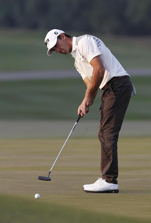 Wade Ormsby of Australia hits a putt on the 17th hole during the Hong Kong Open golf tournament in Hong Kong, Friday, Dec. 6, 2013