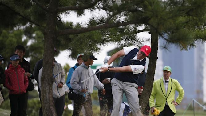 U.S. team member Phil Mickelson hits a shot from a rough on the sixteenth hole during the four ball matches of the 2015 Presidents Cup golf tournament in Incheon