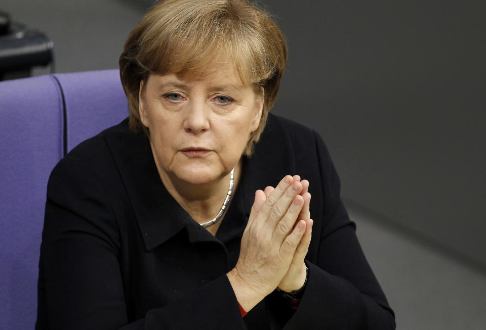 German Chancellor Angela Merkel attends a meeting of the German Federal Parliament, Bundestag, in Berlin, Germany, Friday, Dec. 2, 2011. (AP Photo/Michael Sohn)