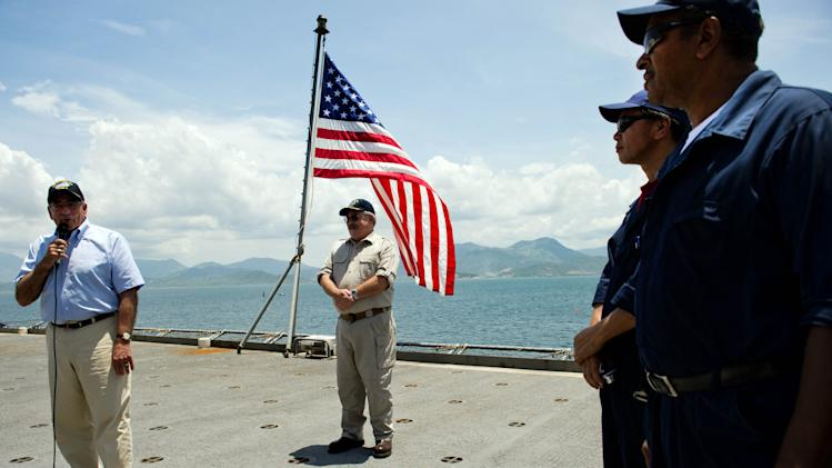 U.S. Secretary of Defense Leon Panetta, left, speaks to crew members as he visits the USNS Richard E. Byrd in Cam Ranh Bay, Vietnam, Sunday, June 3, 2012. Panetta toured the former U.S. air and naval base in the bay, becoming the most senior American official to go there since the war ended. (AP Photo/Jim Watson, Pool)