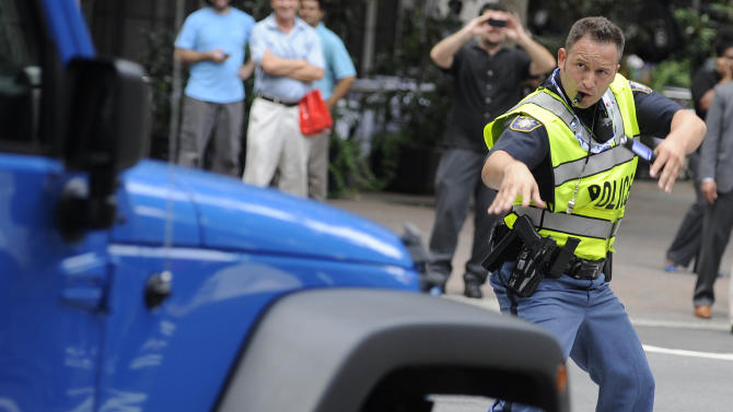 Clayton County (Ga.) Sheriff's Deputy John Strutko dances as he directs traffic Wednesday, Sept. 5, 2012, in Charlotte, N.C., during the second day of the Democratic National Convention. (AP Photo/Mike Stewart)