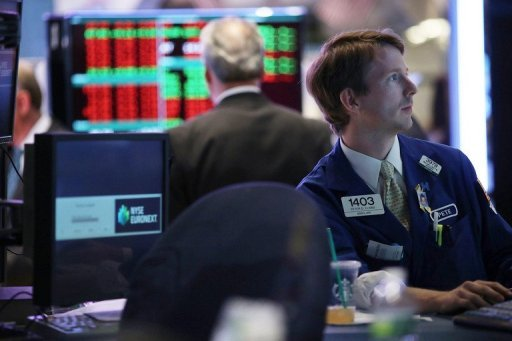 <p>Traders work on the floor of the New York Stock Exchange on August 21. Ben Bernanke's much-anticipated endorsement of more Federal Reserve stimulus Friday gave stocks a solid boost, though tempered by his picture of an economy that remains weak and vulnerable.</p>