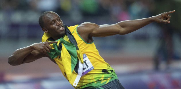 Jamaica&#39;s Usain Bolt poses after his win in the men&#39;s 200 meters at the Summer Olympics in London on Thursday, Aug. 9, 2012. (AP Photo/The Canadian Press, Sean Kilpatrick)