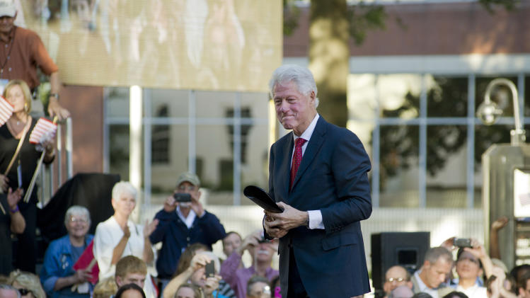 Former President Bill Clinton leaves after addressing a crowd of well wishers at celebration of the 20th anniversary of his announcement to run for President Saturday, Oct. 1, 2011 in Little Rock, Ark. (AP Photo/Brian Chilson)