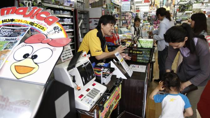 File picture of shoppers lining up in front of cashiers at Don Quijote's central branch store in Tokyo