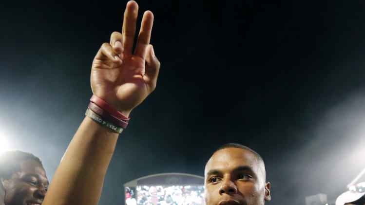 Mississippi State quarterback Dak Prescott (15) waves to the fans after their NCAA college football game against Southern Mississippi at Davis Wade Stadium in Starkville, Miss., Saturday, Aug. 30, 2014. Mississippi State won the season opener, 49-0. (AP Photo/Rogelio V. Solis)