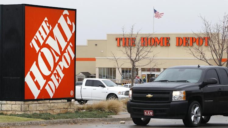 FILE - In a Nov. 14, 2011 file photo a truck pulls out of the parking lot at a Home Depot store in Oklahoma City.   Better sales in the U.S. and healthy demand for its mainstay home-improvement products helped Home Depot's net income rise 13 percent in its fiscal second quarter the company reported Tuesday Aug. 14, 2012.  (AP Photo/Sue Ogrocki)