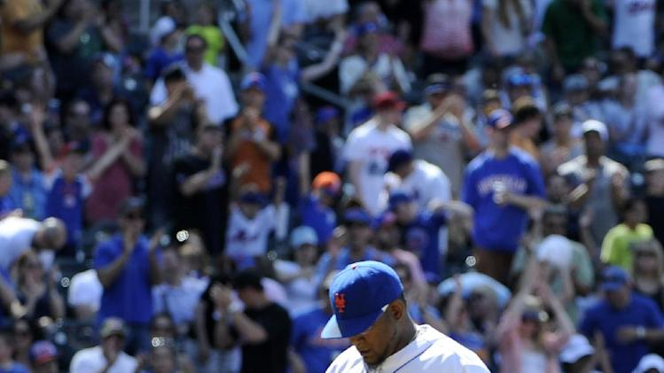New York Mets relief pitcher Jose Valverde (47) pumps his fist after Valverde getting out of a bases loaded eighth inning of game one against the Arizona Diamondbacks in a double header baseball game at Citi Field on Sunday, May 25, 2014, in New York. (AP Photo/Kathy Kmonicek)