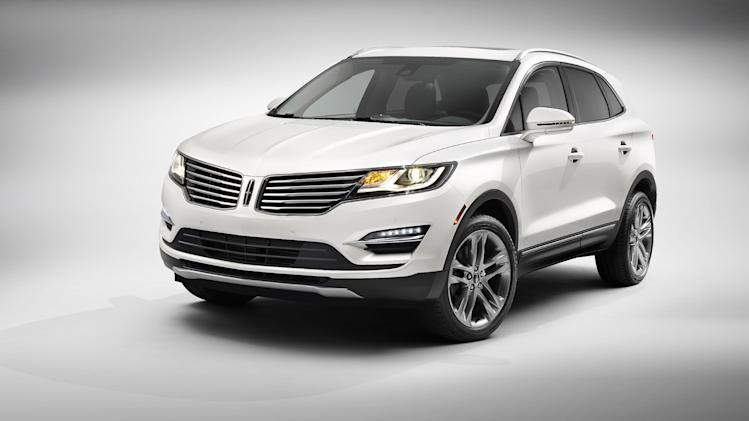 This product image provided by the Ford Motor Company shows the all-new 2015 Lincoln MKC small premium utility vehicle. The new SUV, to be introduced Wednesday, Nov. 13, 2013 in New York, is the second of four new vehicles Ford Motor Co. is counting on to revive its luxury brand. It goes on sale in the U.S. next summer for a starting price of $33,995, making it the least expensive vehicle in Lincoln's lineup. (AP Photo/Ford Motor Company)