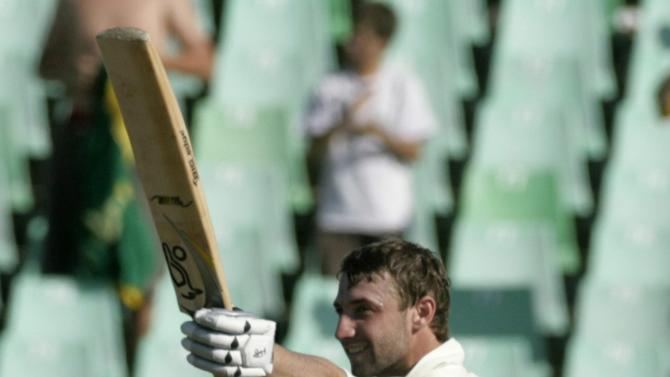 File photo of Australia's Phil Hughes celebrating scoring a century during the third day of the second cricket test match against South Africa in Durban